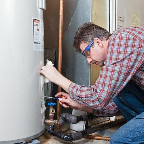 A Plumber Installs a Water Heater.