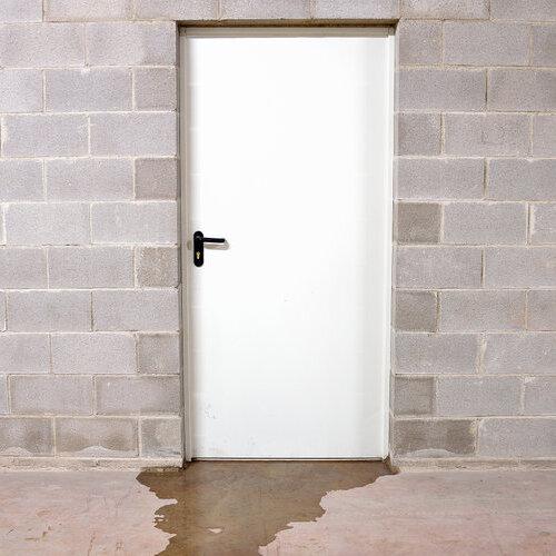 Water leaking from under a door.
