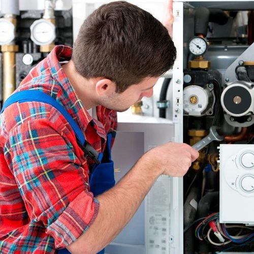 A Plumber Repairing a Device.